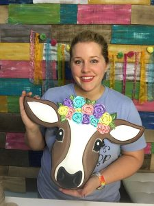 Tamara Bennett with Painted Floral Cow Farm Door Hanger by Southern ADOORnments