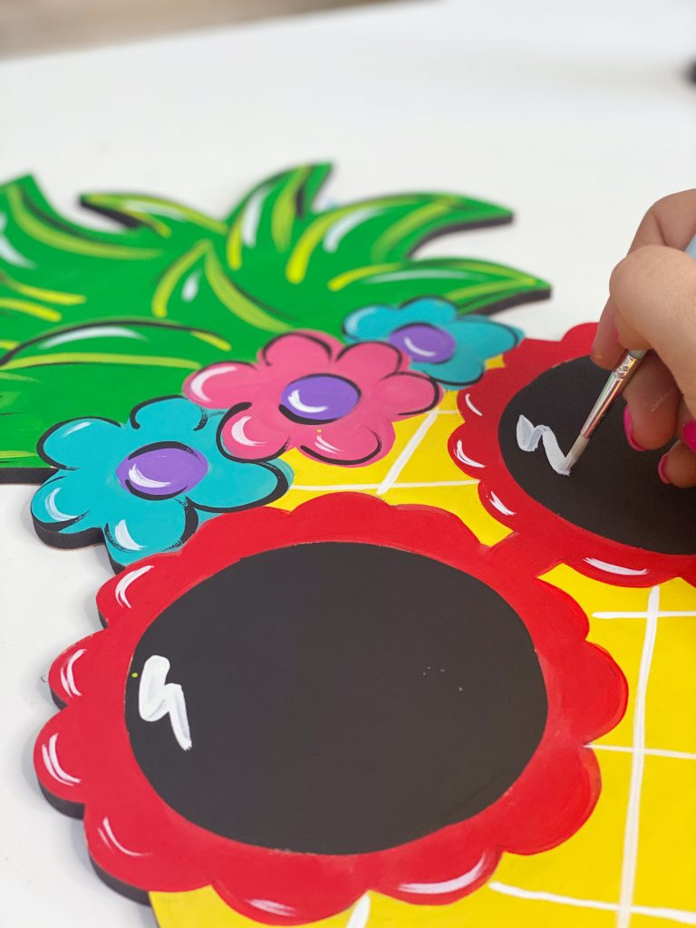 Painting Highlights on Sunglasses Sassy Pineapple Summer Door Hanger by Southern A-DOOR-nments