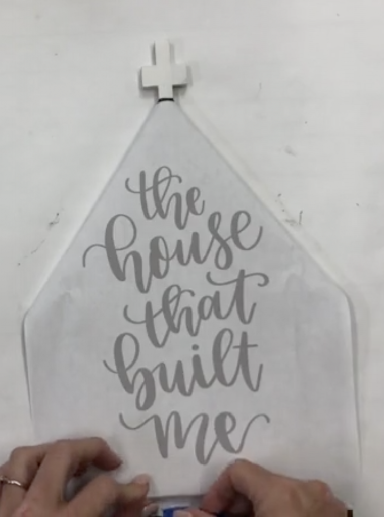 Danielle Stringer hand lettering a church door hanger from Southern Adoornments
