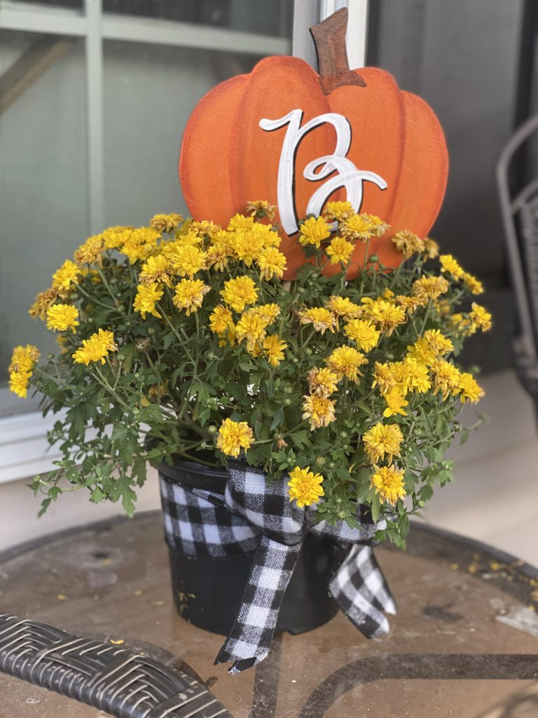 Custom painted wooden pumpkin pick monogram sign inside fall porch mums by southern a-door-nments