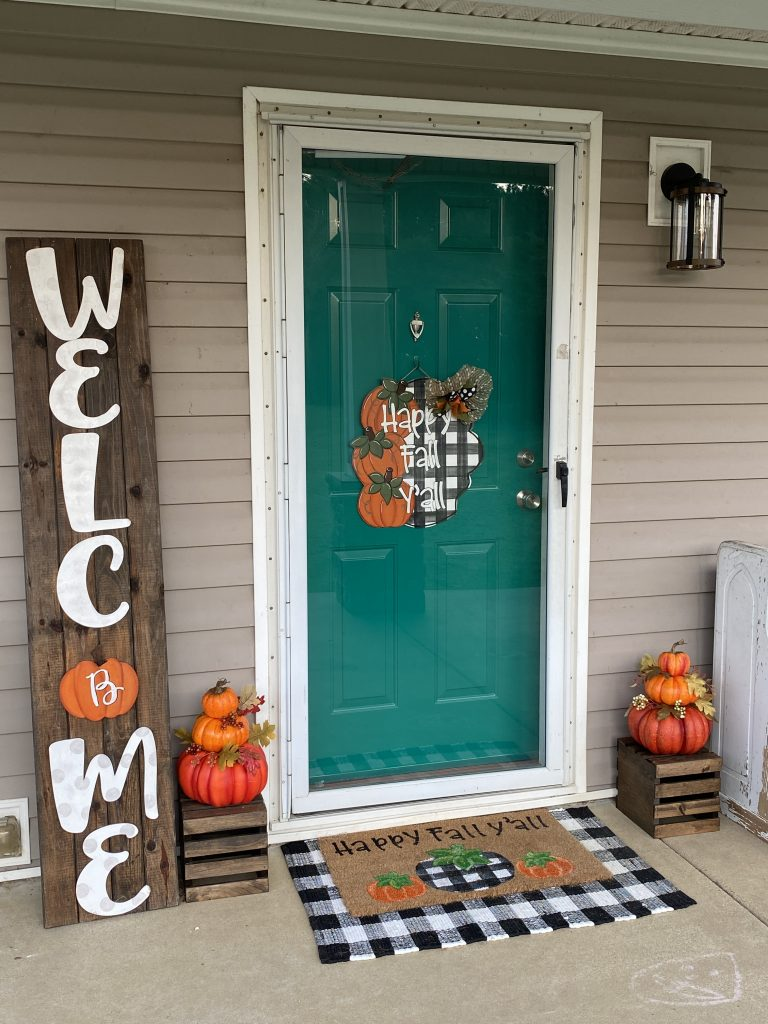 Fall front porch with buffalo plaid and teal door from southern a-door-nments