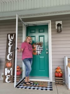 Tamara Bennett fall porch decor with buffalo plaid and pumpkins for southern a-door-nments